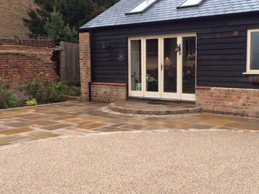 New resin bound driveway with Indian sandstone setts and patio slab area to match.